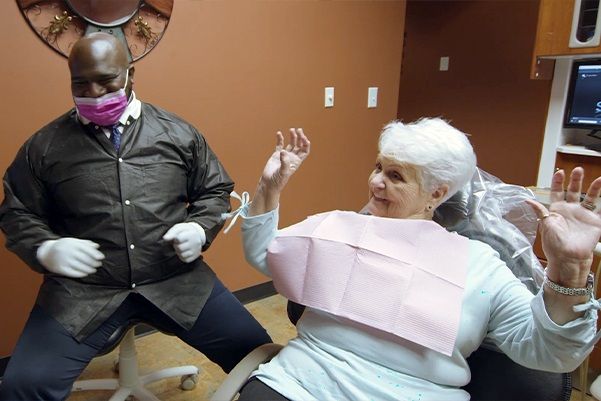 Doctor Marable and older patient laughing in dental office