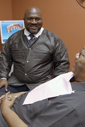 Doctor Marable talking to dental patient