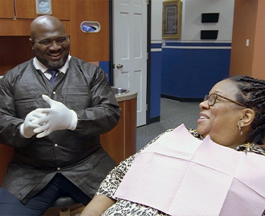 Doctor Marable and patient laughing together